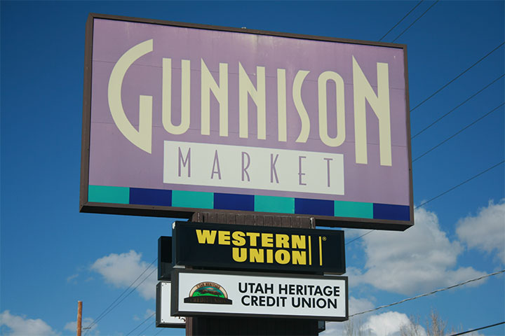 Gunnison Market sign including Utah Heritage sign
