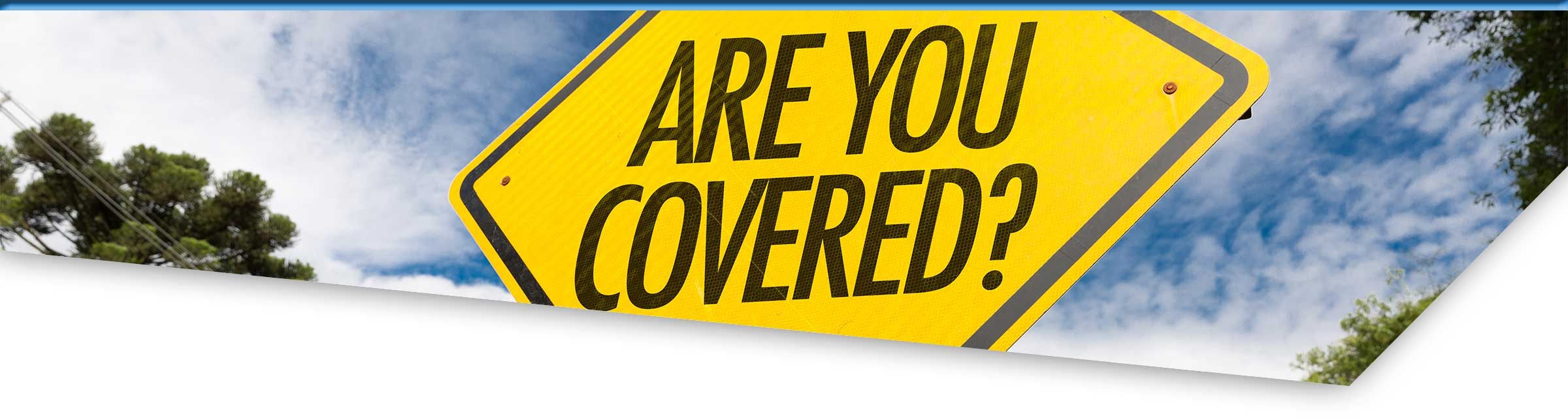 "Warning on a street sign saying ""Are you Covered?"