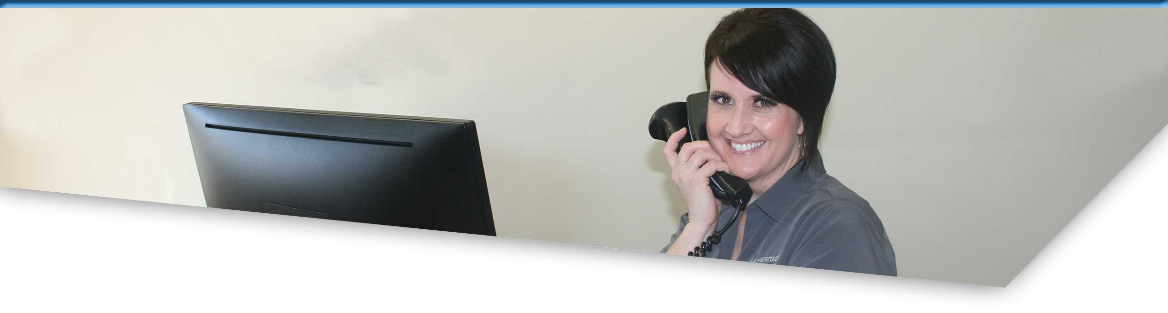 Smiling credit union rep answering the phone
