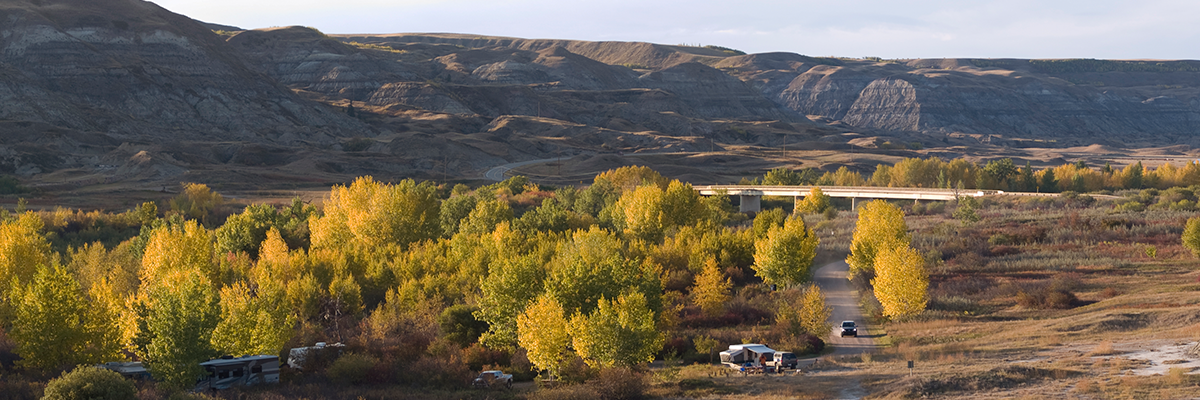 RVs camping in valley with fall foliage