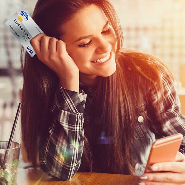 Young woman shopping online with her UHCU Visa